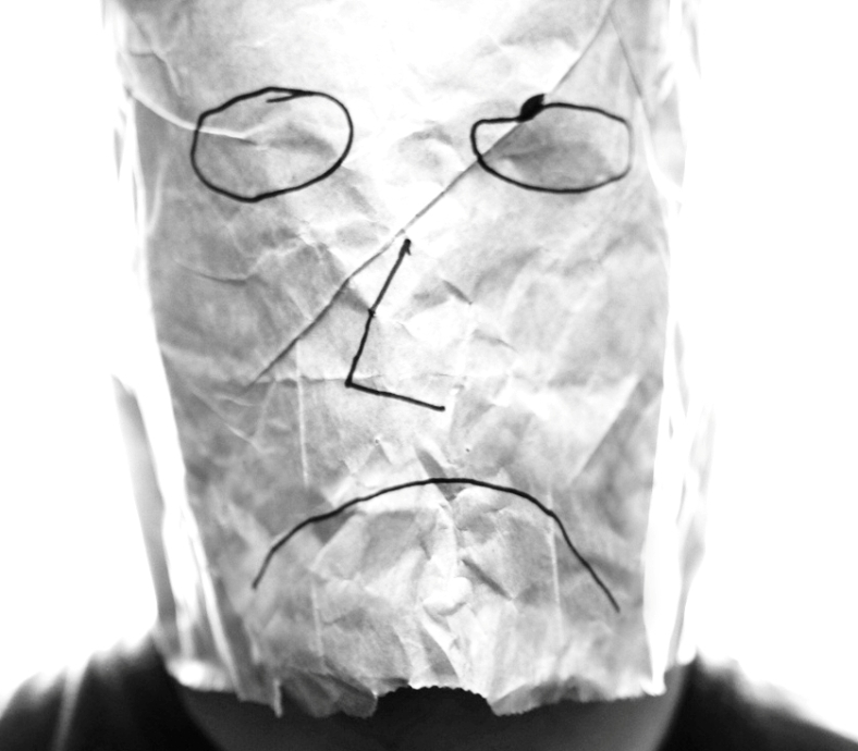 Gray_paper_bag_with_sad_smiley_over_head